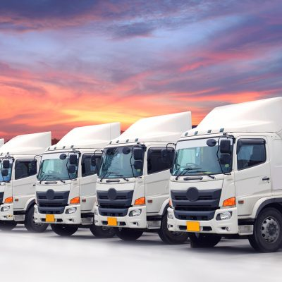 New truck fleet logistics transportation with beautiful sky sunset.